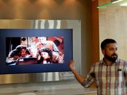 Peter Martinez, co-founder of Refresh Miami explaining the PayPal API (in front of a screenshot from the movie Hackers).