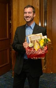 Joshua Smith, director of sales for Material Handling Systems, won his table's centerpiece basket, donated by Creative Corporate Catering.