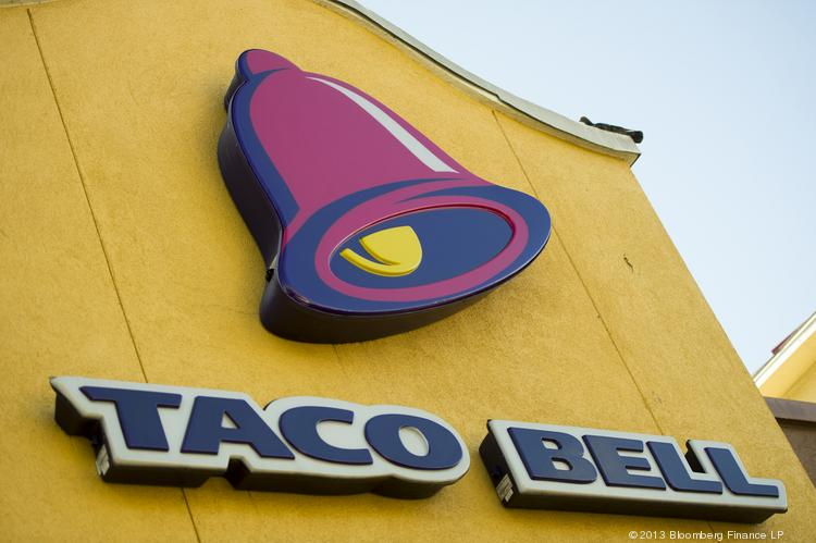 The Taco Bell Corp. logo is displayed on the facade of a restaurant in San Francisco, California, U.S., on Wednesday, March 13, 2013. Taco Bell sales began to pick up last year after its Doritos Locos Tacos mashup generated buzz even among food critics. Will the company be successful with the Waffle Taco?