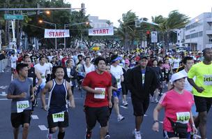Nearly 20,000 participants started the Great Aloha Run near Aloha Tower Marketplace in downtown Honolulu.