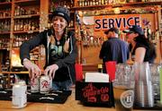 "Bartenders (left to right) Josa Mosman, Sean McAteer  and Jodi Anderson serve up another round at Hooverville Bar during the pre-Seahawks game rush. According to the bar's website, they've served 200 ""gajillion"" pints since 2005 and offer nearly 160 types of hard liquor."