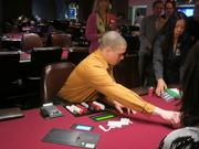 A dealer on Thursday plays a mock game of poker at Maryland Live.