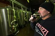 Pyramid Brewing Head Brewer Kim Brusco takes a small test sip of McTut's Woody Dry Irish Stout. McTut's Woody is one of his creations.