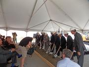 Developers, city officials and others lined up for the traditional first shovelful of dirt to mark the start of the hotel's construction.