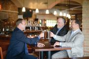 CureIS CEO Chris Sawotin (left), Chief Technology Officer Shawn Alexander and Chief Operating Officer Bret Randolph (right) meet over happy hour.