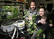 "From left, Ryan and Leanne Lingle, owners, Sodo Hydro (with 16-month-old Evan Lingle) are entwined in ivy at Sodo Hydro, an urban gardening supply store. Sodo Hydro has been doing business in Sodo for three years. ""It's (Sodo's) last stand. The last place where anything has evolved as a neighborhood and it's still evolving. It's coming out of its industrial shell. (Sodo) is now a good mixture of independent businesses."" Ryan Lingle Sodo Hydro ""Because of the third arena, parking is going to be a bear. It's already a bear. We need more parking around here. But foot traffic is up. More people walk past our place."" Leanne Lingle Sodo Hydro"