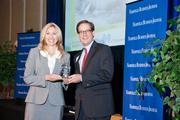 Tom Potter accepts the award for Burr & Formann LLP as the 2013 winner in the 5-99 employee category, with NBJ Publisher Kate Herman.
