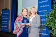 Doreen Wade accepts the award for WSMV-TV as the 2013 winner for the 100-499 employee category, with NBJ Publisher Kate Herman.