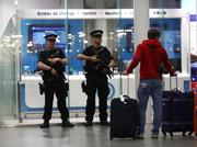 The terror attacks in Belgium led to a security boost in other countries, especially around transportation hubs and tourist destinations. Here, armed police patrol outside a currency exchange at St Pancras International railway station in London, on March 22, 2016.