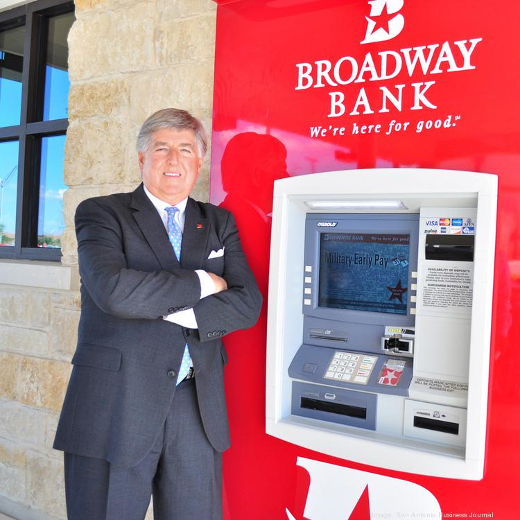 "James ""Jimmy"" Allen, group executive vice president and retail bank division manager for Broadway Bank, shows off some of the new kiosks installed at a branch bank. Allen says new technology is changing expectations for bank branches and expanding the role of bank tellers."