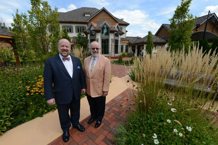 Drs. Charles von Gunten, left, and Frank Ferris, experts in palliative medicine, say OhioHealth's new Kobacker House (behind them) is impressive, but it's not the reason they left San Diego for Columbus.