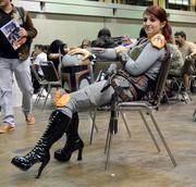 Torry Michalski of Sanford takes in her 3rd MegaCon as a female Boba Fett.
