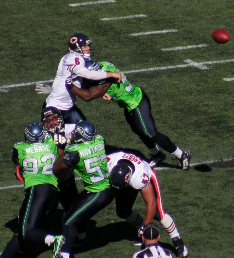 Chicago Bears quarterback Jay Cutler gets hit by a Seattle Seahawks player leading with the crown of his helmet. The National Football League has been criticized in recent years for doing too little to combat head injuries.