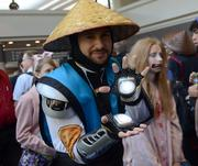 Raiden from Mortal Kombat. Looks like he already put the smack-down on the girl in the background.