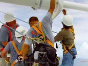 Workers install turbines on top of Hilton Fort Lauderdale Beach Resort.