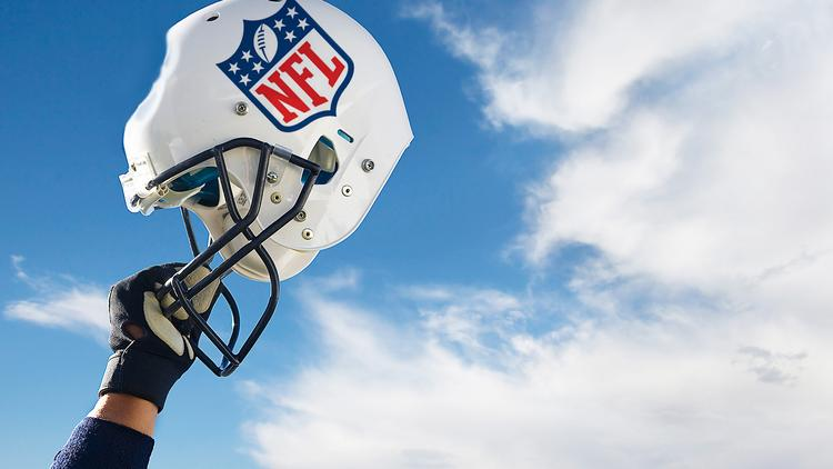A federal judge has preliminarily approved a settlement between ex-players and the NFL regarding compensation or head injuries.