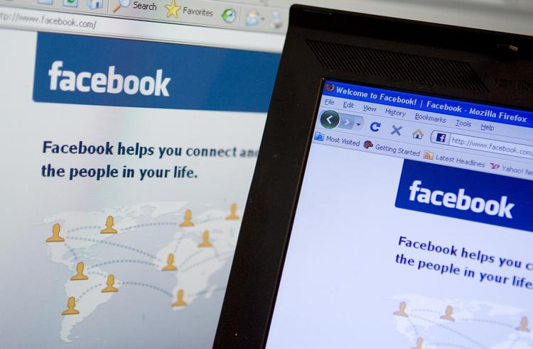 The Facebook homepage is displayed on a computer monitor.