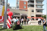 Neil Bortz, a principal with Towne Properties, speaks during the ribbon cutting ceremony.