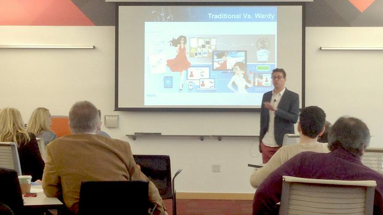 Brian Toone of Lee's Summit-based Contra Software LLC talks about the company's new fashion-oriented consumer app, Gussy, during a 1 Million Cups event in Kansas City.