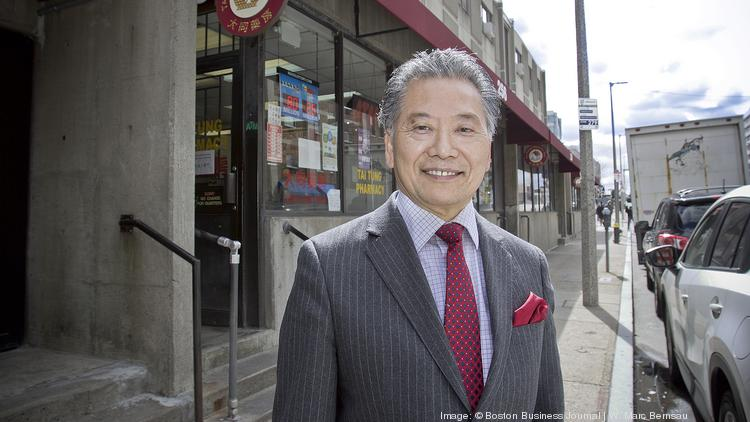 S. Nick Chau outside his family businesses Tai Tung Realty and Tai Tung Pharmacy on Harrison Avenue in Boston's Chinatown.