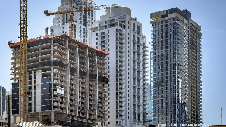 Construction continues at the 1010 Brickell condo project at left.