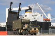 Marines from II Marine Expeditionary Force drive a logistics vehicle system replacement, LVSR, carrying an intermodal container that was offloaded from the United States Naval Ship Dahl during a Marine Prepositioning Force Exercise aboard Marine Corps Support Facility Blount Island, Fla., May 28, 2013. During the exercise, Marines worked in conjunction with sailors to move equipment from the USNS Dahl to designated areas aboard Blount Island. (U.S. Marine Corps photo by Lance Cpl. Shawn Valosin)