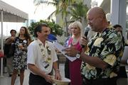 Pacific Business News Publisher Bob Charlet does a few give-aways as guests socialize at PBN's Pau Hana at the Modern Waikiki.