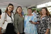 From left, Leilani Pemberton and Teddi Anderson of The Limtiaco Co.,  Judy Magin of Aflac and Janis Magin of Pacific Business News.
