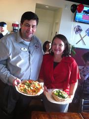 Mike Sims is the franchisee for Your Pie in Northeast and Central Florida. His wife Dea helped out opening night.