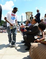 Tracy Martin, father of Trayvon Martin, greets Martin Luther King III.