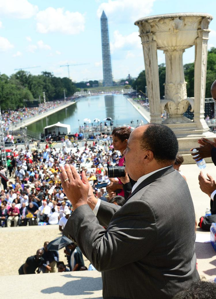 Martin Luther King III cheers as he prepares to speak to the crowd attending march on the Lincoln Memorial.