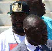 Tracy Martin, father of Trayvon Martin, listens with family attorney Ben Crump.