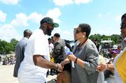 Tracy Martin, father of Trayvon Martin, greets Merial Evers Williams, wife of Medgar Evers.
