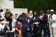John Lewis waves to the crowd as he takes the stage to speak.