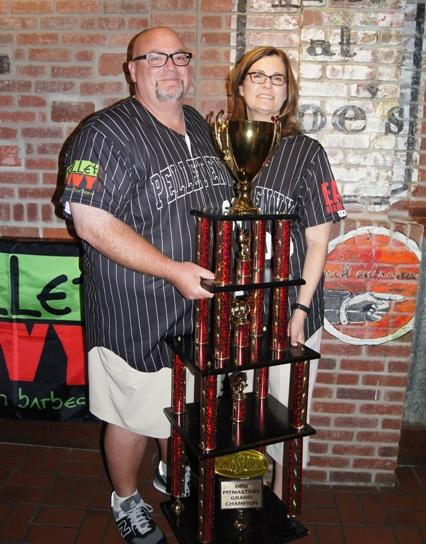 Rod Gray shows off the trophy he took home as BBQ Pitmaster Grand Champion.  He plans to invest the $50,000 award back into his business.
