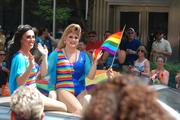 Parade participants wave to the crowd at Charlotte Pride.