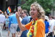 Jennifer Roberts, former chair of the Mecklenburg Board of County Commissioners, greets spectators at the Charlotte Pride 2013 parade. Mayor Patsy Kinsey and Charlotte City Council members Billy Maddalon and Lawana Mayfield also participated in the parade.