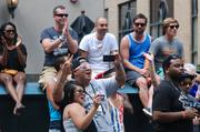 Spectators cheer as the parade marches past on Tryon Street.