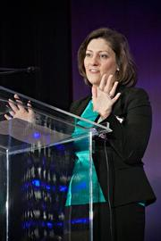 Christine Freyermuth, assurance partner, health industries at PwC, recipient of the Emerging Leader award, acknowledges the award at the Boston Business Journal's Advancing Women breakfast.