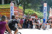 A group of protesters makes its way through the Charlotte Pride festival crowd following the parade Sunday afternoon.