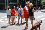 """A festival attendee poses for a photo with """"Miss Charlotte Pride."""""""