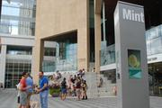 Charlotte Pride festival attendees mingle on the steps of The Mint Museum uptown.