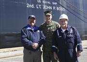 The Assistant Commandant of the Marine Corps, Gen. John M. Paxton, Jr. poses for a photo with personal in front of the USNS Second Lieutenant John P. BOBO during a visit to Marine Corps Support Facility-Blount Island, Jacksonville, FL, Feb. 20, 2013. The trip was part of a larger visit with Marines aboard installations under Marine Corps Logistics Command (LOGCOM). (U.S. Marine Corps photo by Cpl. Tia Dufour/Released)