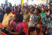 Baltimore Design School students raise their hands as Mayor Stephanie Rawlings-Blake asks them questions about their first day of school, including whether or not they brushed their teeth. Students started the school year in a new building at 1500 Barclay St. in the Station North Arts and Entertainment District.