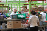 Toyota helped the Houston Food Bank make its food sorting processes more efficient and safe.