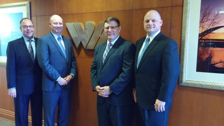 From left, CEO Mike Conway, chief development officer Terry Dammeyer, CFO Kent Bruggeman and COO Brian Perkins partnered with Pyramid Hotel Group to form the new Winegardner & Hammons Hotel Group.