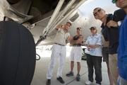 Before taking off, pilot Sam Bass explains the history of the B-17 bomber to his passengers.