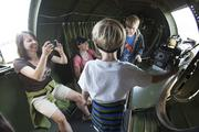 Sara Haessler of Massachusetts takes a photo of her son while in flight.