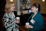 Alexandra Quinn of WB Engineers and Karyn Martin of 451 Marketing chat over coffee during the social hour at the Boston Business Journal's Advancing Women breakfast held at the Sheraton Boston.