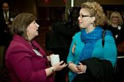 Cheryl Burke of DiCicco Gulman & Company speaks with Debbie Millin of UpperLevel Solutions during the social hour at the Boston Business Journal's Advancing Women breakfast held at the Sheraton Boston.